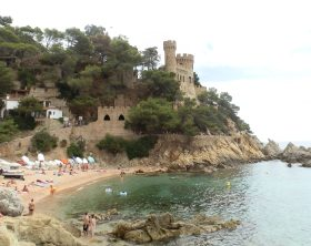 Beach and Castell dEn Plaja at the end of Lloret beach
